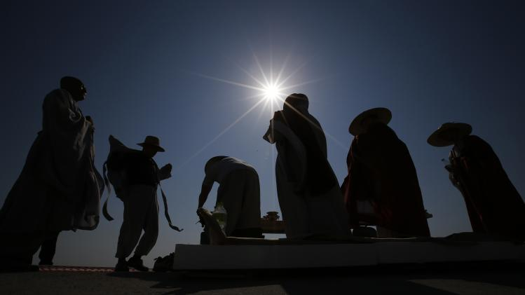 Buddhist monks prepare to pray for the missing and dead passengers onboard the capsized Sewol ferry at a port in Jindo