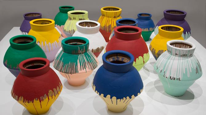 """In this undated photo made available by the Brooklyn Museum of Art, shows a series of 16 vases that are part of an installation by Chinese artist Wei Wei and currently on display at the Perez Art Museum in Miami. Artist Maximo Caminero broke one of the vases on Sunday, Feb. 16, 2014. Caminero told officers he broke the vase to protest the museum's lack of local artist displays and because """"the museum only displayed international artists' art,"""" according to the affidavit. The Wei Wei exhibit was to be displayed next at the Brooklyn Museum of Art. (AP Photo/Brooklyn Museum of Art)"""