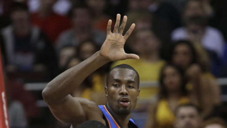 Cleveland Cavaliers' Tristan Thompson, front, drives past Oklahoma City Thunder's Serge Ibaka, from the Republic of Congo, during the first quarter of an NBA basketball game on Saturday, Feb. 2, 2013, in Cleveland. (AP Photo/Tony Dejak)