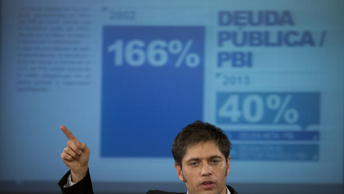 FILE - In this June 17, 2014 file photo, Argentina's Economy MInister Axel Kicillof talks to the media during a news conference to explain the recent U.S. Supreme Court's ruling on Argentina's bond default and discuss how the government plans to proceed, in Buenos Aires, Argentina. For over a decade, Argentina avoided paying $1.5 billion it owed to U.S. hedge funds for defaulted bonds. But after the U.S. Supreme Court refused to intervene in the case this week, the country must pay up by the end of this month. (AP Photo/Eduardo Di Baia, File)