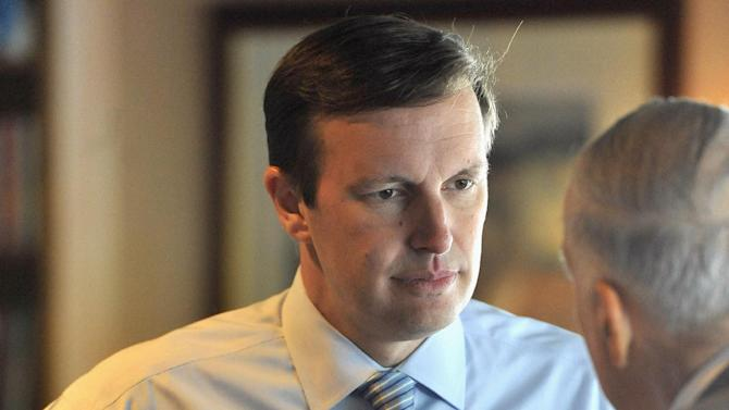 In this Wednesday, Sept. 19, 2012 photo, Democratic candidate for U.S. Senate Chris Murphy, left,, talks with Matt Dominello Sr, right, at a diner in Meriden, Conn. Wealthy former pro wrestling executive Linda McMahon is shifting her image from groin-kicking CEO to grandmother in her second bid for a Senate seat from Connecticut. Polls show the strategy seems to be working against three-term Democratic congressman Murphy.(AP Photo/Jessica Hill)