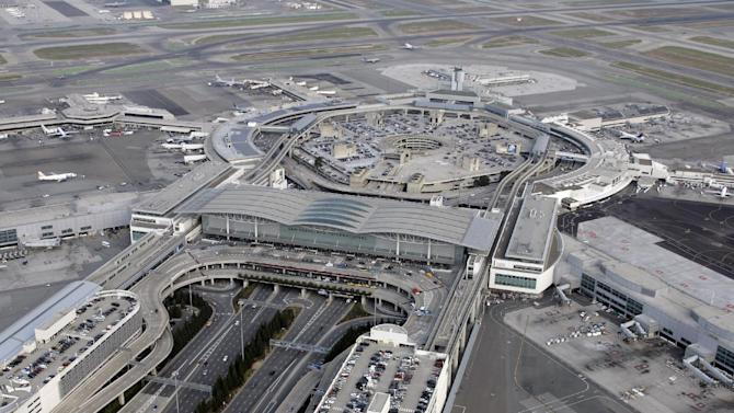 FILE - San Francisco International Airport in San Francisco, is shown in a Thursday, Nov. 8, 2007 aerial file photo. A charter amendment sponsored by city Supervisor David Campos on Tuesday, Jan. 15, 2013 planned to introduce legislation asking voters to rename the city's airport after slain gay rights leader Harvey Milk. The amendment would put the question of creating Harvey Milk-San Francisco International Airport on San Francisco's November ballot. Milk became one of the first openly gay men elected to public office in the United States when he won a seat on the board of supervisors in 1977. He was assassinated at City Hall, along with Mayor George Moscone, more than a year later.   (AP Photo/Eric Risberg, File)