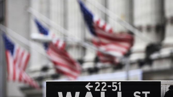 FILE - This file photo made April 22, 2010 shows a Wall Street sign in front of the New York Stock Exchange. U.S. stock futures rose on Wednesday, May 21, 2014, as investors await the minutes from the Federal Reserve's most recent meeting in April. (AP Photo/Mark Lennihan, File)