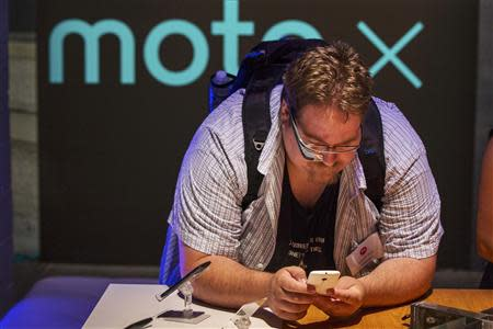one of Motorola's new Moto X phones at a launch event in New York