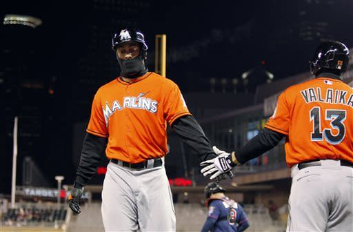 Marlins beat Twins to split day-night doubleheader