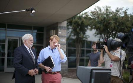 Chris Hurst, a journalist at the station and boyfriend of killed journalist Alison Parker pauses for a moment as Jeff Marks, general manager for WDBJ7 looks on