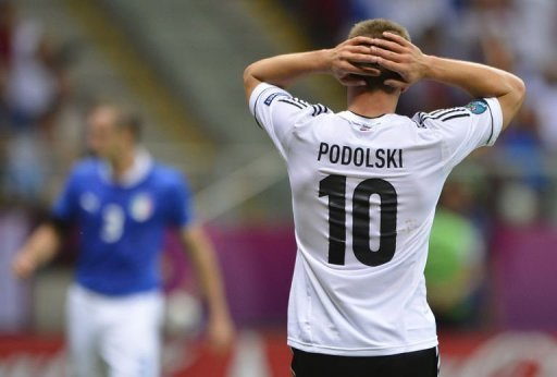 German forward Lukas Podolski reacts during the match