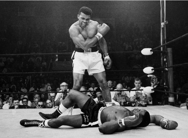 FILE -  In this May 25, 1965, file photo, heavyweight champion Muhammad Ali stands over fallen challenger Sonny Liston, after dropping Liston with a short hard right to the jaw in Lewiston, Maine.  Al