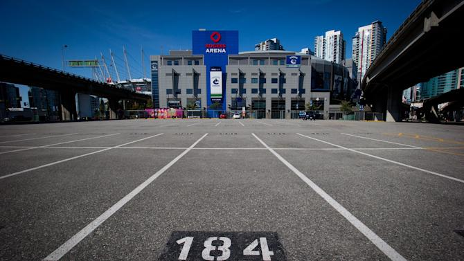 Rogers Arena, the home of the Vancouver Canucks NHL hockey team, is pictured from a parking lot across the street from the arena in Vancouver, British Columbia, on Sunday Sept. 16, 2012. The NHL locked out its players at midnight Saturday, the fourth shutdown for the NHL since 1992, including a year-long dispute that forced the cancellation of the entire 2004-05 season. (AP Photo/The Canadian Press, Darryl Dyck)