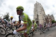 Germany's Dominik Nerz (C) rides past a church with Great Britain's Mark Cavendish (L) during the 197 km and third stage of the 2012 Tour de France cycling race starting in Orchies and finishing in Boulogne-sur-Mer, northern France. Slovakian champion Peter Sagan continued his impressive start to his Tour de France debut with his second stage win inside three days on Tuesday