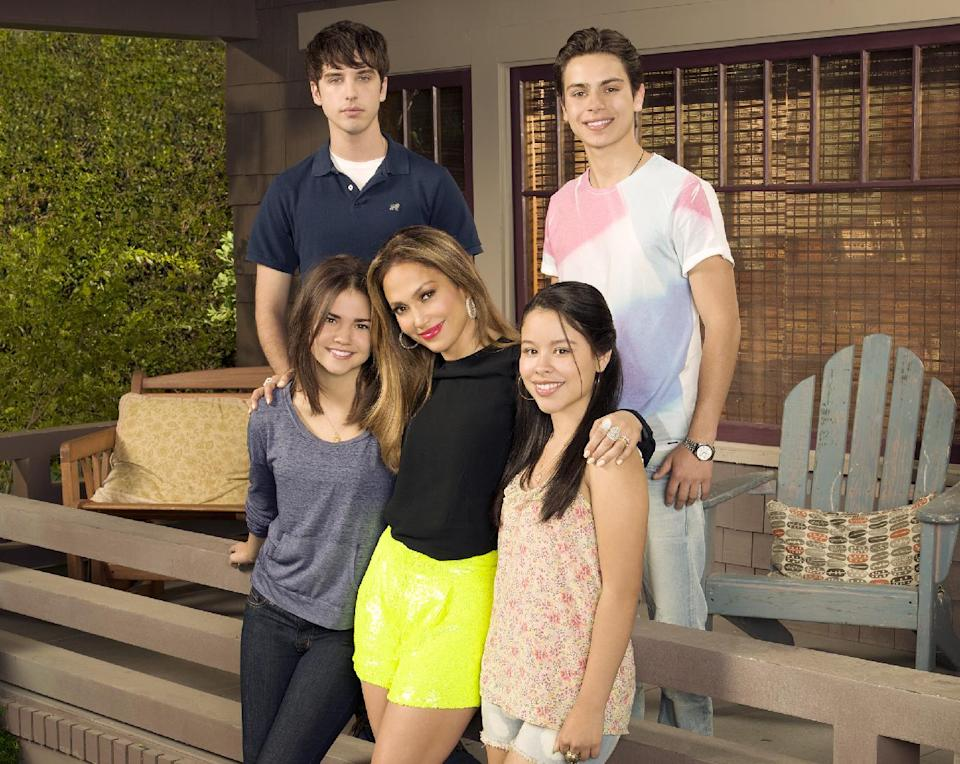 "This undated image released by ABC Family shows, from row from left, Maia Mitchell, executive producer Jennifer Lopez, Cierra Ramirez, from back left, David Lambert and Jake T. Austin from ""The Fosters,"" premiering June 3 on ABC Family. (AP Photo/ABC Family, Bob D'Amico)"