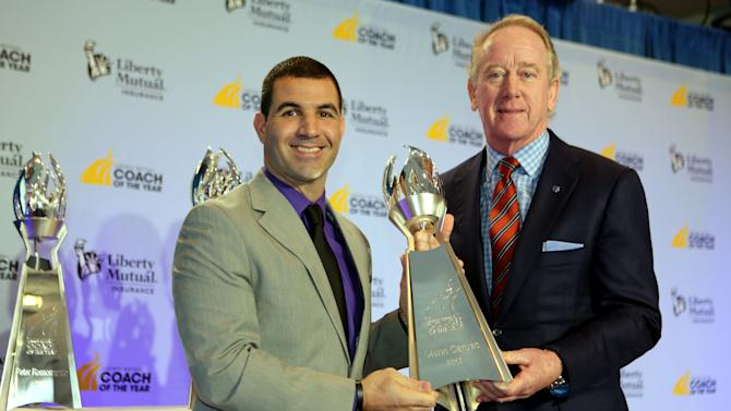 IMAGE DISTRIBUTED FOR LIBERTY MUTUAL INSURANCE - 2012 Liberty Mutual Coach of the Year Award winner Glenn Caruso, St. Thomas, poses for photos with Archie Manning (R) at the 2012 Liberty Mutual Coach of the Year Award Winners Announcement, on Monday, Jan. 7, 2013 in Ft. Lauderdale, Fla. (Photo by Marc Serota/Invision for Liberty Mutual Insurance/AP Images)