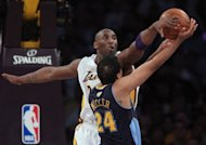 Kobe Bryant of the Los Angeles Lakers blocks a shot by Andre Miller of the Denver Nuggets during the first half in Game One of the Western Conference Quarterfinals in the 2012 NBA Playoffs at Staples Center in Los Angeles, California. The top-seeded San Antonio Spurs and perennial contenders the Los Angeles Lakers opened the NBA Western Conference playoffs with emphatic victories on Sunday