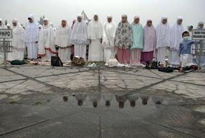 Muslim women pray for rain to put out the fires which…