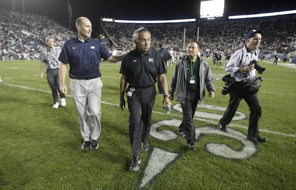Hawaii head coach Norm Chow, center, walks off the field at the end of their NCAA college football game with Brigham Young Friday, Sept. 28, 2012, in Provo, Utah.BYU defeated Hawaii 47=0.   (AP Photo/Rick Bowmer)