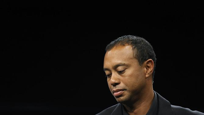 In this March 24, 2014, file photo, Tiger Woods looks down during a news conference at the Newseum in Washington, Monday, March 24, 2014. Woods will miss the Masters for the first time in his career after having surgery on his back. Woods said on his website that he had surgery Monday, March 31, in Utah for a pinched nerve that had been hurting him for several months