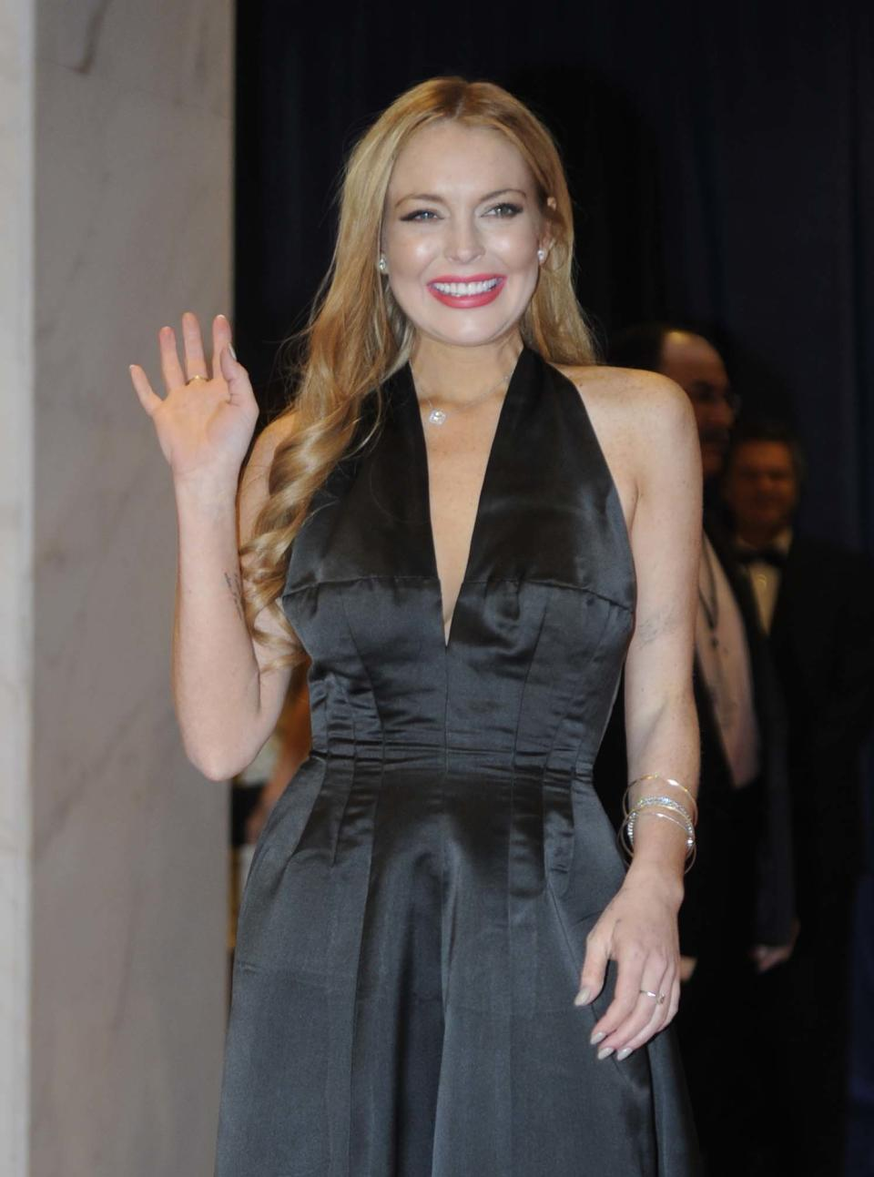 Actress Lindsay Lohan arrive at the White House Correspondents' Association Dinner on Saturday, April 28, 2012, in Washington.  (AP Photo/Kevin Wolf)