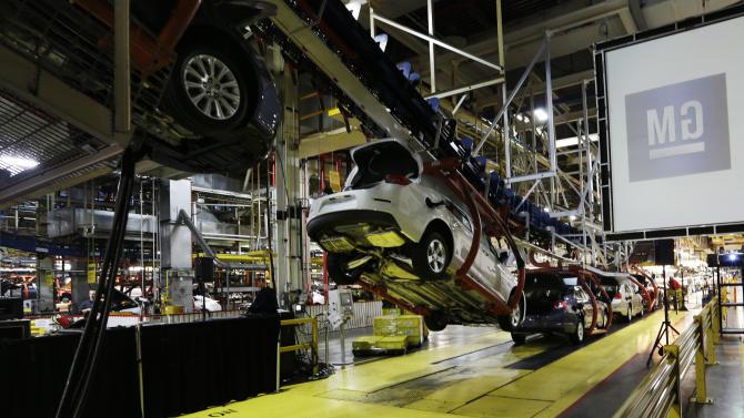 GM turns 2012 profit despite losses in Europe