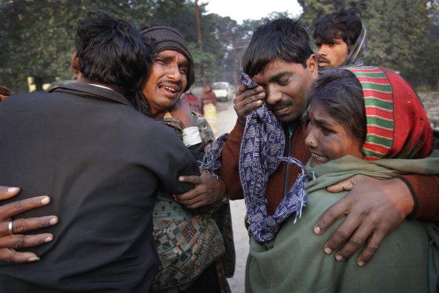 An Indian family whose relative died in a stampede at a railway station cry and comfort each other as they arrive to take the bodies from morgue, in Allahabad, India, Monday, Feb. 11, 2013. The death