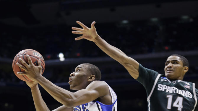 Duke guard Rasheed Sulaimon (14) goes up to the basket  with a shot past Michigan State guard Gary Harris (14) during the second half of a regional semifinal in the NCAA college basketball tournament, Friday, March 29, 2013, in Indianapolis. Duke won 71-61. (AP Photo/Michael Conroy)