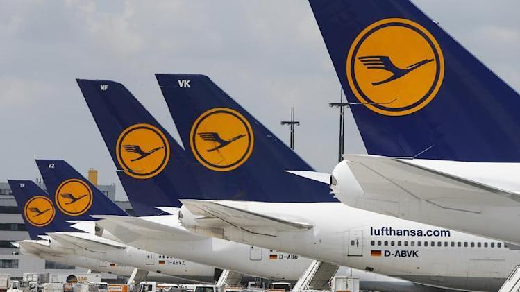 Lufthansa aircrafts sit on the tarmac at Frankfurt airport