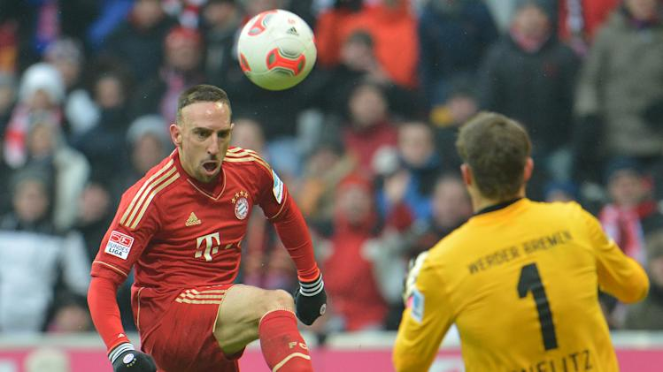 Bayern's Franck Ribery of France, left, scores against  Bremen's goalie Sebastian Mielitz during the German first division Bundesliga soccer match between FC Bayern Munich and SV Werder Bremen  in Munich, Germany, Saturday, Feb. 23, 2013. (AP Photo/Kerstin Joensson)