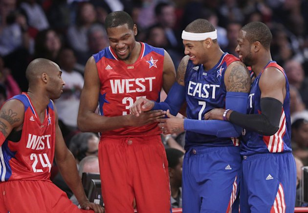 From left, West Team's Kobe Bryant, Kevin Durant, East Team's Carmelo Anthony and Dwyane Wade laugh during the first half of the NBA All-Star basketball game Sunday, Feb. 17, 2013, in Houston. (AP Photo/Eric Gay)