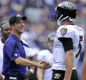 Baltimore Ravens coach John Harbaugh, left, shakes hands with quarterback Joe Flacco in the final minutes of an NFL football game against the Pittsburgh Steelers in Baltimore, Sunday, Sept. 11, 2011. Baltimore won 35-7. (AP Photo/Nick Wass)