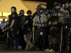 Police is riot gear work to disperse a crowd of protesters …