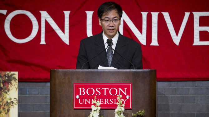 The Deputy General Consul for the People's Republic of China, New York, Zhong Ruiming delivers a message on behalf of the Consulate General of he People's Republic of China, New York, during Lu Lingzi's memorial service at Metcalf Hall in Boston University's George Sherman Student Union on Monday, April 22, 2013. Lingzi was killed in the Boston Marathon bombings. (AP Photo/The Boston Globe, Dina Rudick, Pool)
