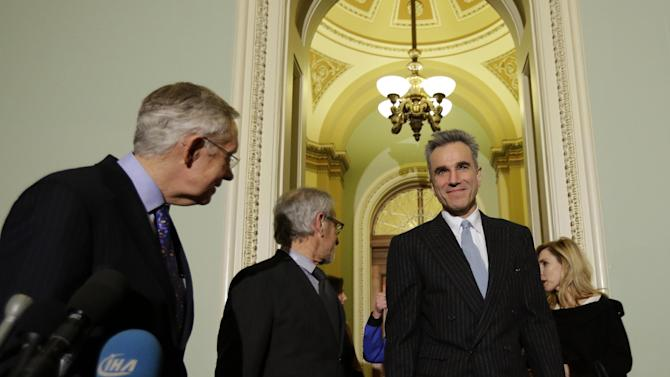"Senate Majority Leader Harry Reid of Nevada, left, with director Steven Spielberg, center, and cast member Daniel Day-Lewis, and others, arrive for a media availability before a screening of the movie ""Lincoln,"" for members of Congress, on Capitol Hill, Wednesday, Dec. 19, 2012 in Washington. (AP Photo/Alex Brandon)"