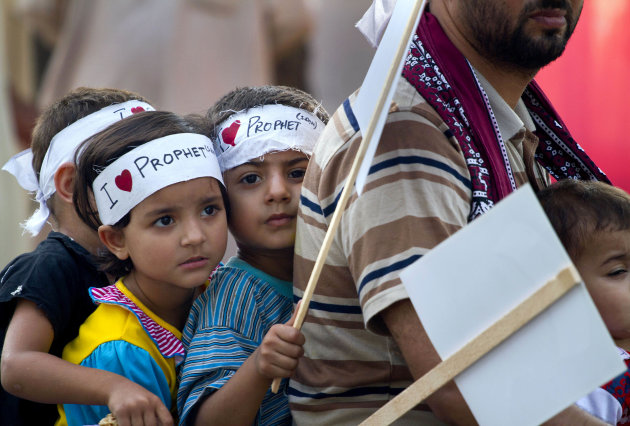 Children wear headbands reading &#39;I love Prophet&#39; as they ride on a motorbike during a demonstration that is part of widespread anger across the Muslim world about a film ridiculing Islam&#39;s Prophet Muhammad, Saturday, Sept. 22, 2012 in Islamabad, Pakistan. (AP Photo/Anjum Naveed)