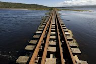 File picture shows a section of railway line at Swartvlei Lagoon close to Knysna, South Africa. More than 30 people were on Friday killed in South Africa when a train ploughed into a truck carrying dozens of farm workers on a railway line, an official said