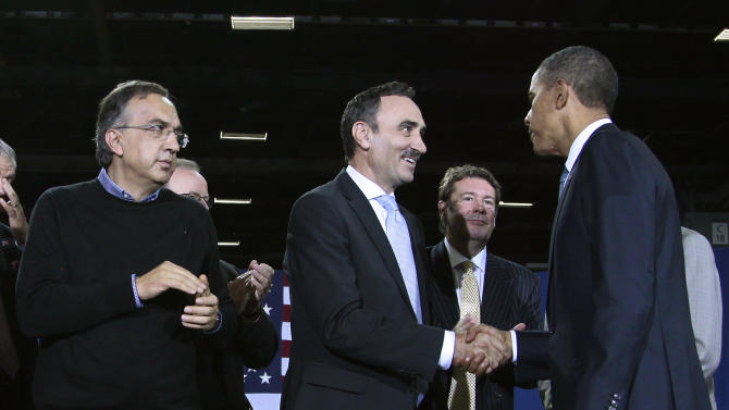 President Barack Obama greets BMW Manufacturing Co President Josef Kerscher at the Washington Convention Center, Friday, July 29, 2011. From left are, Fiat-Chrysler CEO Sergio Marchionne, Kerscher, the president and Mazda North American Operations CEO James O'Sullivan.  (AP Photo/Pablo Martinez Monsivais)