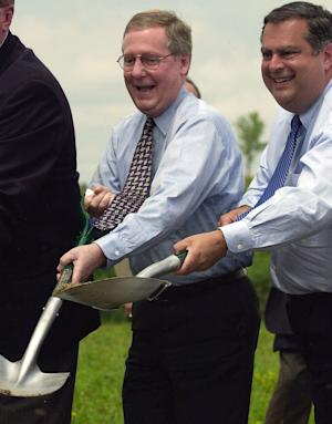 FILE -In this Monday July 2, 2001, file photo, U.S. Secretary of Energy Spencer Abraham, right, and U.S. Sen. Mitch McConnell participate in a groundbreaking ceremony for a new power plant which will use clean coal technology, near Hindman, Ky. President Barack Obama's new plan to impose stricter federal emissions standards on coal-fired power plants has drawn sharp criticism from McConnell. Kentucky is among the nation's top coal producers. (AP Photo/James Crisp, File)