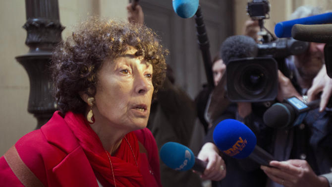 """Francoise Rudetzki, a representative for terrorism victims, answers reporters outside the courtroom where Venezuelan convicted terrorist known as """"Carlos the Jackal"""", or Illich Ramirez, is due to appear  Monday, May, 13, 2013 in Paris. Carlos the Jackal, the flamboyant terrorist and self-proclaimed revolutionary who was once one of the Cold War's most wanted men, is appealing his life sentence for orchestrating bombings in France two decades ago. Carlos, whose real name is Ilich Ramirez Sanchez, is serving two life sentences in France for a triple murder in 1975 and for the bombings in France in 1982 and 1983 that killed 11 people and injured more than 140. He's been jailed since French agents seized him in Sudan in 1994. (AP Photo/Michel Euler)"""