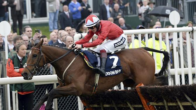 The New One ridden by Sam Twiston Davies clear a hurdle as they go onto win the Doom Bar Aintree Hurdle during the opening day of the Aintreee Festival at Aintree Racecourse, Liverpool England Thursday April 3, 2014. (AP Photo/John Giles/PA) UNITED KINGDOM OUT