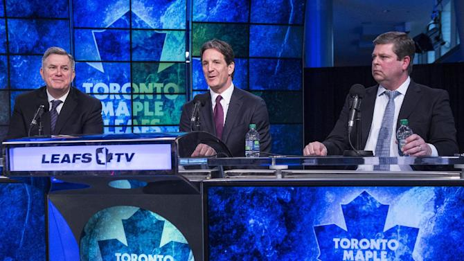 Tim Leiweke, from left, president and CEO of Maple Leaf Sports and Entertainment, sits with new Toronto Maple Leafs president Brendan Shanahan and General manager Dave Nonis during a news conference in Toronto on Monday, April 14, 2014. Shanahan, a Hockey Hall of Famer, says he's eager to get to work learning about the organization, which missed the playoffs after a late-season collapse