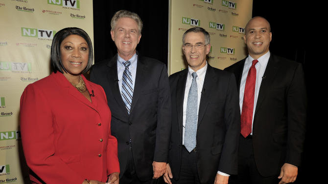 In this photo provided by NJTV, from left, Assembly Speaker Sheila Oliver, Rep. Frank Pallone, Rep. Rush Holt, and Newark Mayor Cory Booker, pose for photos before the U.S. Senate Democratic Primary debate televised on NJTV from Montclair State University in Montclair, N.J. on Monday, Aug. 5, 2013. The four candidates are on the ballot for the Aug. 13 party primary election. Two Republicans, Alieta Eck or Steve Lonegan, are also running. The winner of the Oct. 16 election will fill the remainder of the late Sen. Frank Lautenberg's term. (AP Photo/NJTV, Joseph Sinnott)
