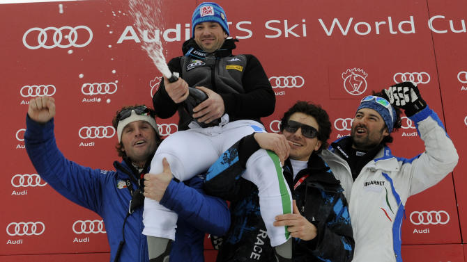 Italy's Cristian Deville celebrates with team's staffers after winning an alpine ski, men's World Cup slalom, in Kitzbuehel, Austria, Sunday, Jan. 22, 2012. Cristian Deville of Italy won a men's World Cup slalom Sunday, while defending overall champion Ivica Kostelic finished third to win the combined event and go top of the overall rankings. (AP Photo/Giovanni Auletta)