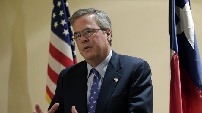 FILE - In this Feb. 26, 2013, file photo, former Florida Gov. Jeb Bush talks with the media following his address on education to the Texas Business Leadership Council in Austin, Texas. Bush writes in a new book that the nation needs to completely overhaul its immigration policies but cautions against providing a pathway to citizenship for illegal immigrants, a position that puts him at odds with some Senate reformers within his own party. (AP Photo/Eric Gay, File)