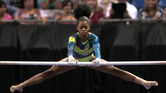 Gabby Douglas competes on the uneven bars during the women's senior division at the U.S. gymnastics championships on Sunday, June 10, 2012, in St. Louis. (AP Photo/Jeff Roberson)