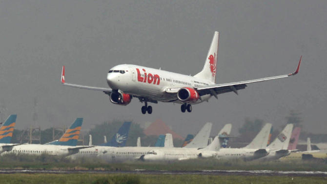 FILE - In this May 12, 2012 file photo, a Lion Air passenger jet takes off from Juanda International Airport in Surabaya, Indonesia. Indonesia's top discount carrier Lion Air, which catapulted into the global aviation spotlight with record deals to buy Airbus and Boeing planes, is taking the battle for Asia's budget-minded travelers to the backyard of the airline that helped pioneer low cost flights in the region. (AP Photo/Trisnadi, File)