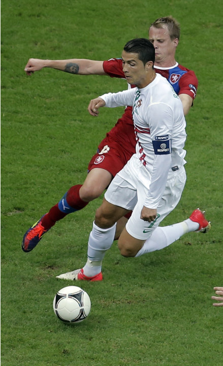 Portugal's Cristiano Ronaldo is tackled by Czech Republic's David Limbersky during the Euro 2012 soccer championship quarterfinal match between Czech Republic and Portugal in Warsaw, Poland, Thursday,