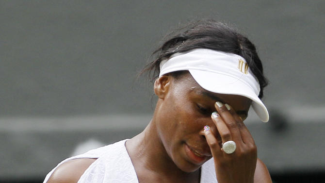 Venus Williams of the US reacts during her match against Bulgaria's Tsvetana Pironkova at the All England Lawn Tennis Championships at Wimbledon, Monday, June 27, 2011. (AP Photo/Kirsty Wigglesworth)