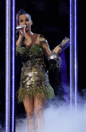 "Katy Perry reacts after winning Best Video for ""California Gurls"" at the MTV European Music Awards 2010, in Madrid, Sunday, Nov. 7, 2010. (AP Photo/Joel Ryan)"