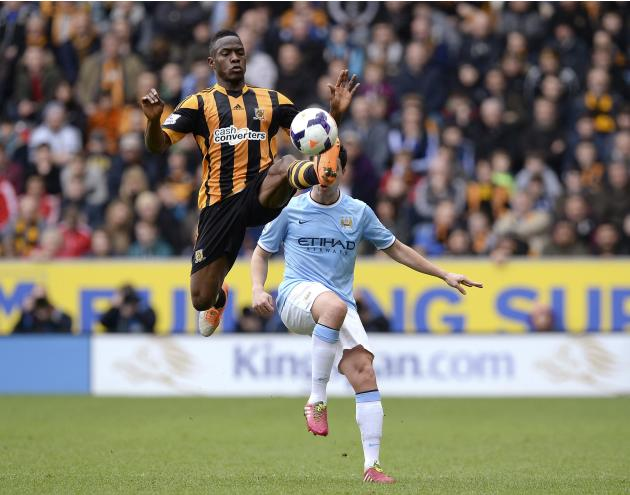 Hull City's Figueroa challenges Manchester City's Nasri during their English Premier League soccer match in Hull