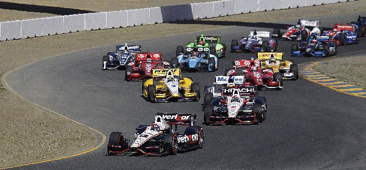 Will Power (12), of Australia, leads Ryan Briscoe (2) and the rest of the pack at the start of the IndyCar Series auto race on Sunday, Aug. 26, 2012, in Sonoma, Calif. (AP Photo/Ben Margot)