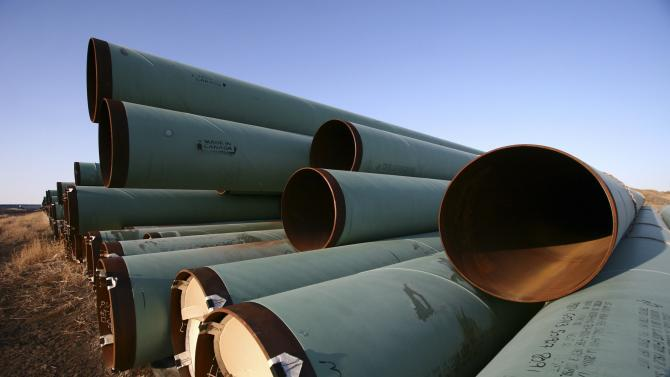 Pipes for underground fuel transport for TransCanada Corp.'s Keystone XL pipeline lie in a field in Gascoyne