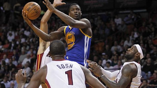 Golden State Warriors' Harrison Barnes shoots as Miami Heat's LeBron James looks on (R) in the second half of their NBA basketball game in Miami (Reuters)
